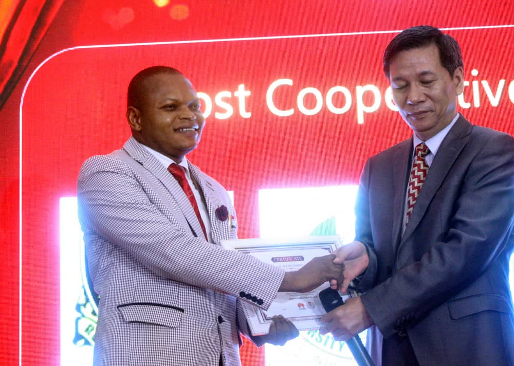 Dr. B.O.Omijeh Recieving the most cooperative Huawei ICT academy AWARD on behalf of the VC, UniPort at the 2018/19 Huawei ICT Award Ceremony at Sherato Hotel Abuja FCT, Thursday July 4th, 2019